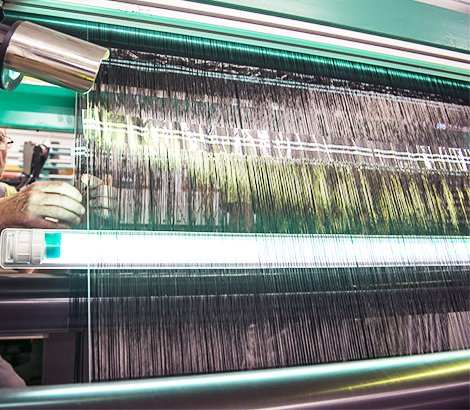 Ajustement sur machine textile